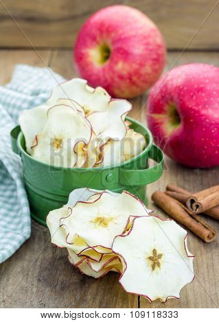 Healthy Snack. Homemade Apple Chips On Rustic Wooden Background