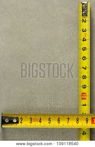 tape measure at old background texture