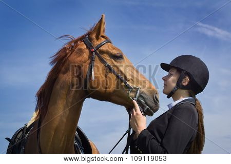 Beautiful Young Girl Jockey Talks With Her Horse