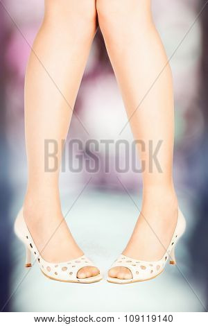 beautiful legs in a comfortable elegant shoes on abstract background