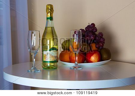 Bottle and glasses on the table