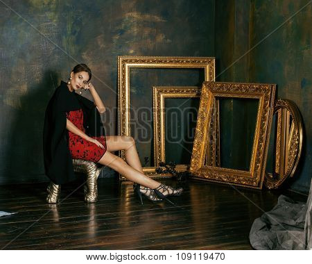 beauty rich brunette woman in luxury interior near empty frames, vintage elegance hispanic