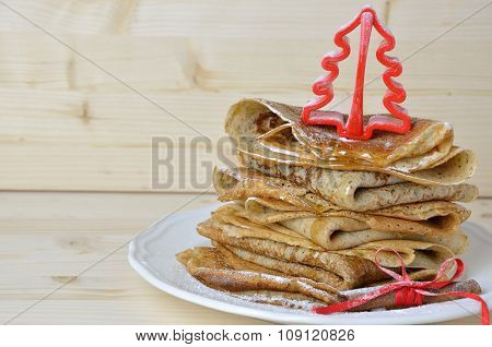 Pancakes With Honey And Christmas Decoration