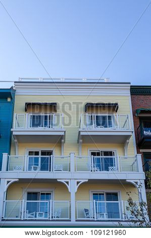 Six White Balconies On Yellow Wood Building