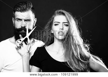 Fashionable Couple With Scissors