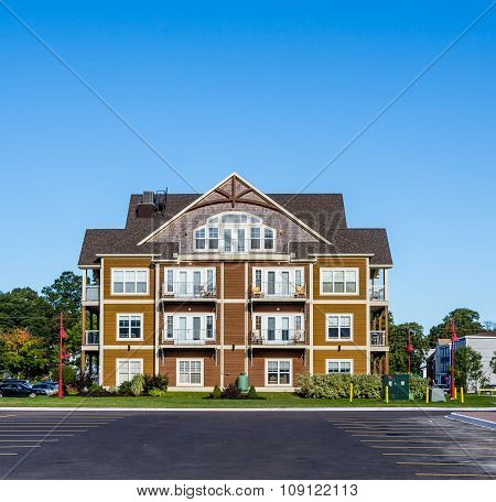 Small Condo Building Under Blue Skies