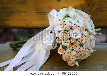 Wedding Bouquet On Wooden Bench