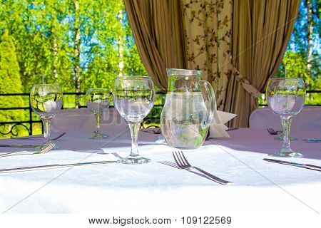 Table with glasses and white tablecloth