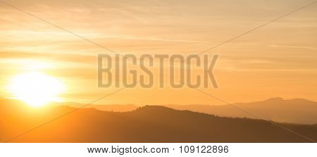 Orange Sunset Behind Mountain Range