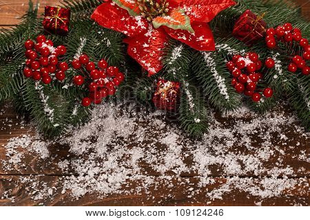Beautiful Christmas Background With The Branches Of The Christmas Tree And Snow On Wooden Background