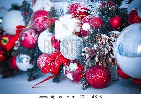 Beautiful Christmas Decoration With Snow, Buds And Christmas Balls. Blue Toned