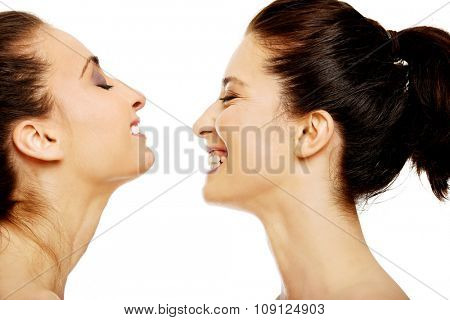 Two attractive laughing women with make up.