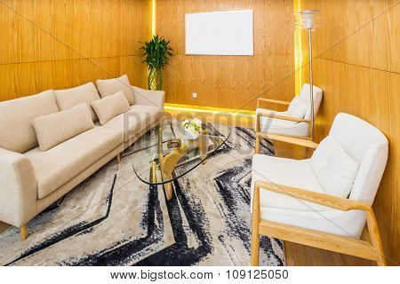background wall and table,chair and table,blanket in livingroom of villa