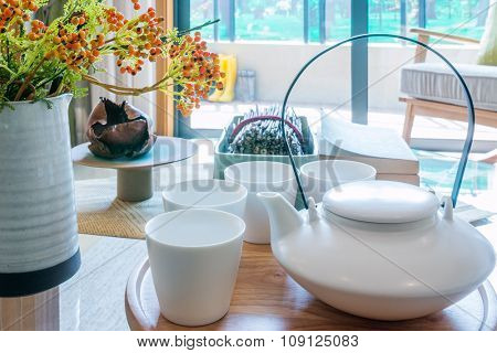 teapot, cup and vase on table in living room