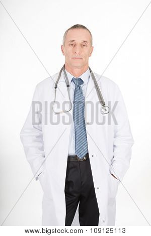 Confident male doctor with hands in pockets.