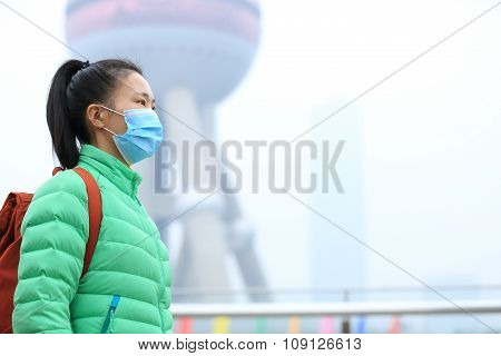 young woman tourist wear a mask at shanghai city