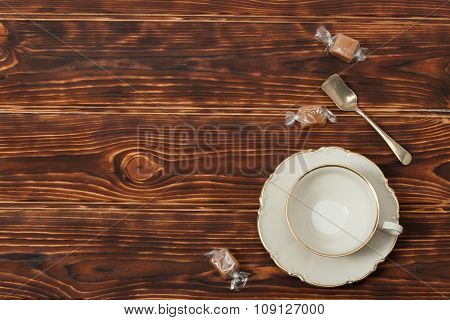 Empty Cup and Plate Of Fine Bone China. Sweets. Burnt Wooden Bac