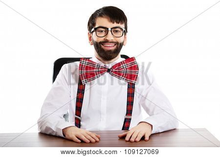 Funny old fashioned man sitting by a desk.