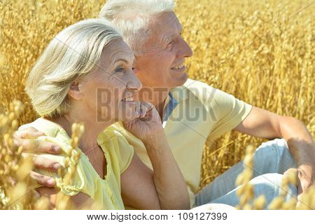 Loving mature couple in field