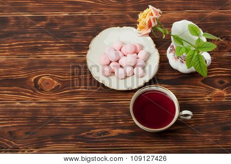 Tea Cup and Plate Of Fine Bone China. Sweets. Rose. Burnt Wooden