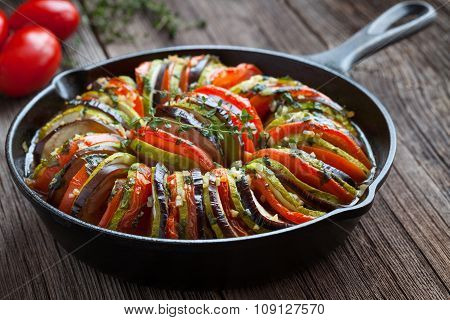 Traditional homemade vegetable ratatouille baked in cast iron frying pan healthy diet french vegetar