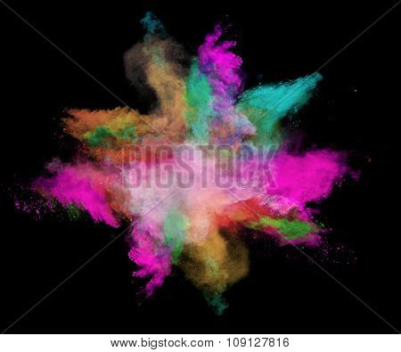 Freeze motion of colored dust explosions isolated on black background