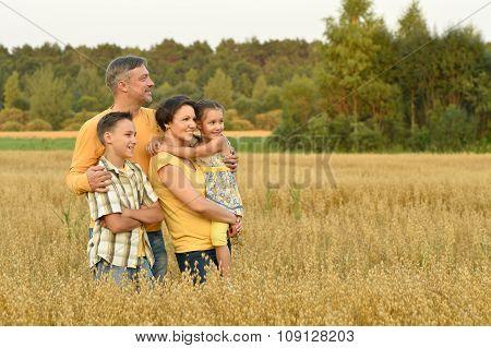 Happy family in wheat field