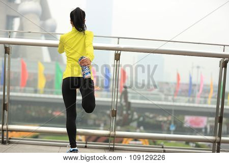 young fitness woman runner  warm up at city