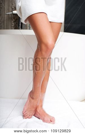 Beautiful woman legs wrapped in towel.