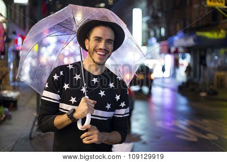 Traveler exploring the city on a rainy night. Chinatown, New York