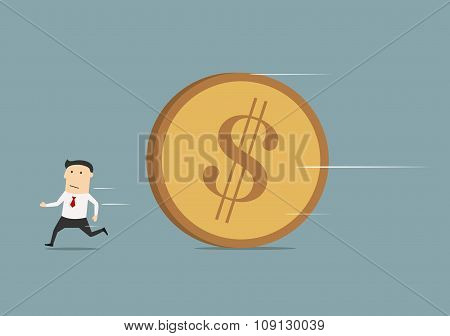 Businessman running away from big coin