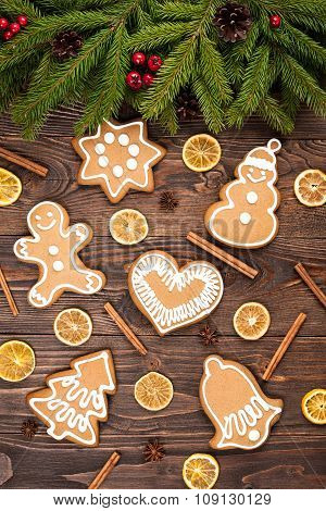 Fir Tree And Christmas Gingerbread Cookies On Dark Wooden Background