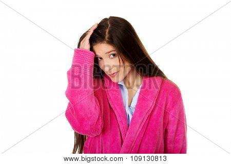 Beautiful caucasian woman wearing pink bathrobe.