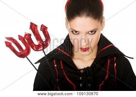 Beautiful serious angry woman in devil carnival costume.