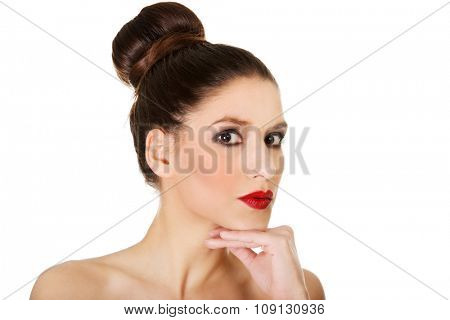 Attractive brunette topless woman with dark make up.