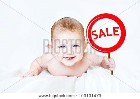 Smart Little Boy Holding A Sign