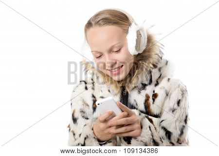 Happy Girl In Winter Outfit Using Cellphone