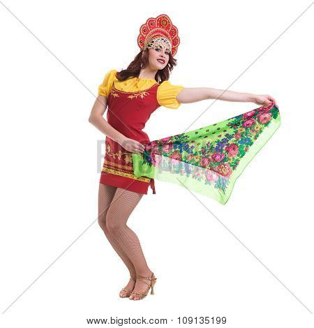 Young woman wearing a folk costumes dancing.  Isolated on white in full length with copyspace