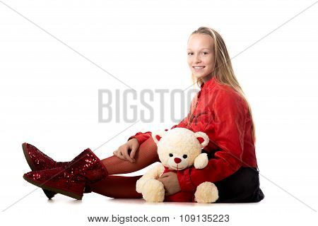 Girl Sitting With Toy