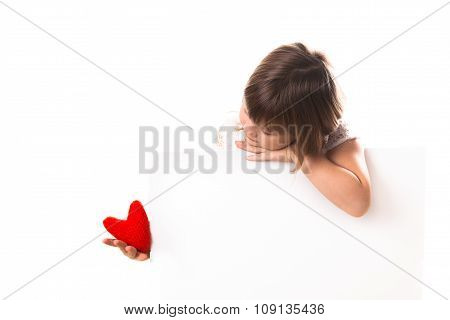 Serious Baby Girl With Red Heart In Hand, A Place Inscription