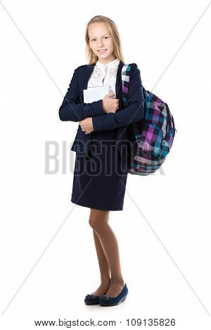 Smiling School Girl With Pile Of Books