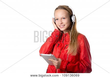 Girl Listening To Music On Tablet