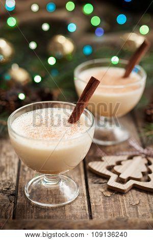 Eggnog traditional christmass egg, milk, rum, vanilla alcoholic liqueur preparation recipe with cinn