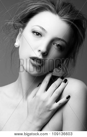 Woman in Black and White. pearl earrings