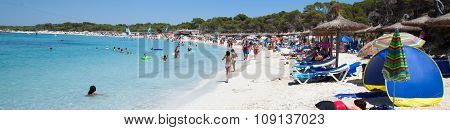COLONIA DE SANT JORDI PALM SPAIN - JULY 16 2011: People in Es Trenc beach with white sand and turquoise sea Es Trenc is not attached to any resort so it is fairly isolated and has a wild and natural feel.