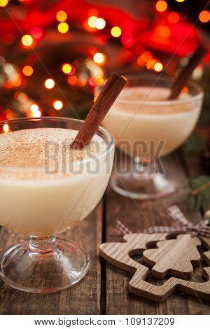 Eggnog traditional homemade christmass celebration egg, milk, rum, vanilla liqueur alcohol drink wit