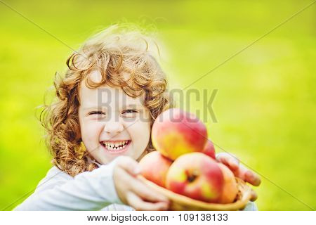 Happy Girl Holding A Basket Of Apples.