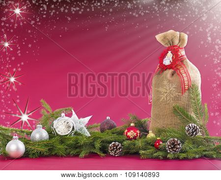 Christmas background with jute sack, fir branches and cones.