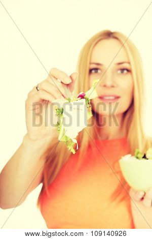 Happy pregnant woman eating healthy salad