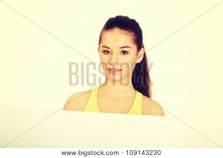 Fitness woman with white empty banner.